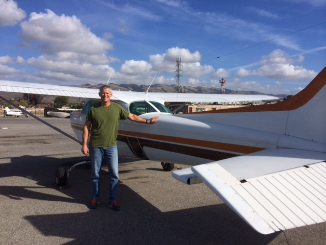 Scott Williams with our newest C172RG, N4604V, on the fleet after a successful checkride!