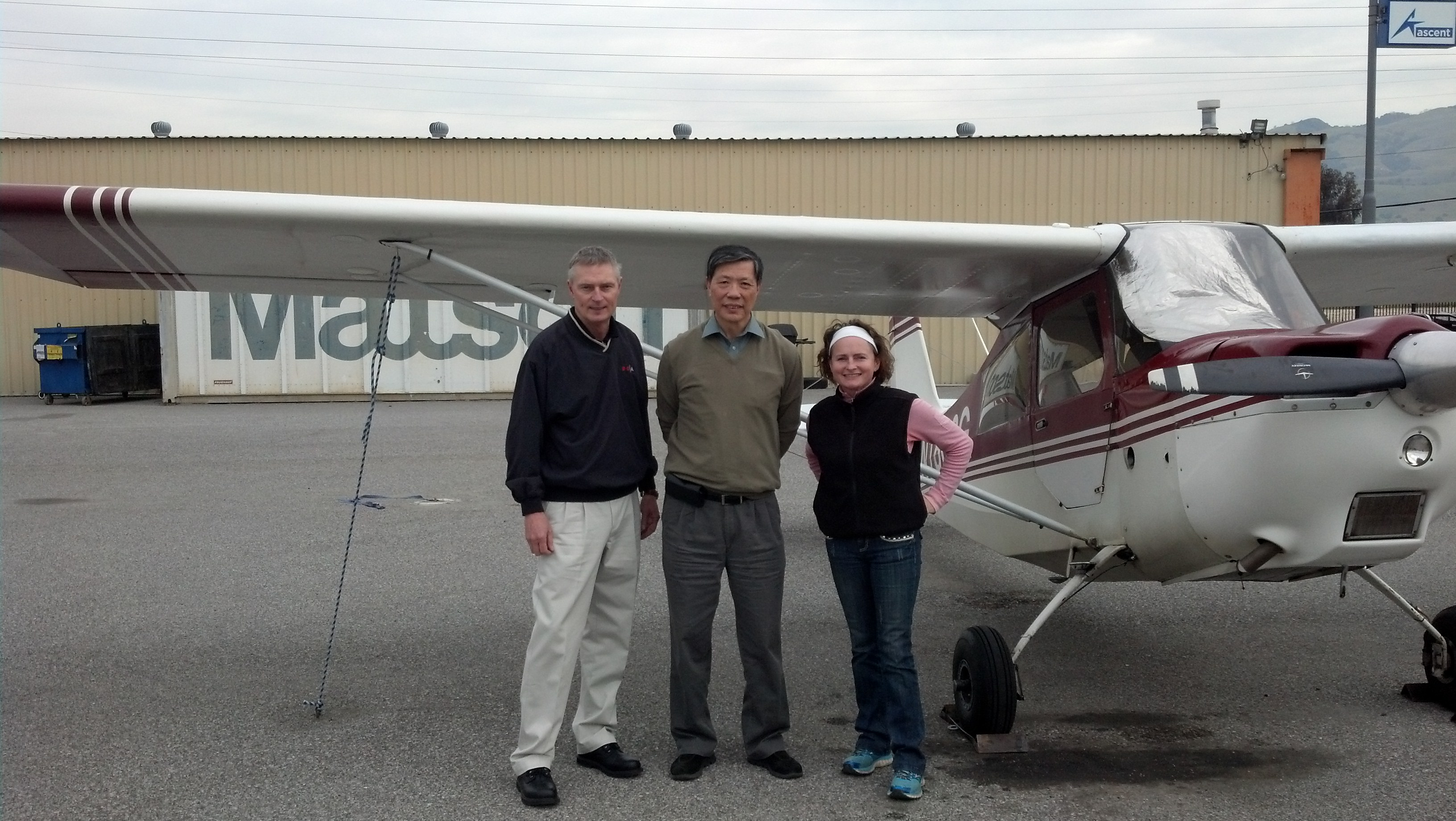 CFI Grainne Gilvarry joins DPE Scott Rohlfing and Ching Lee after a well executed checkride flight