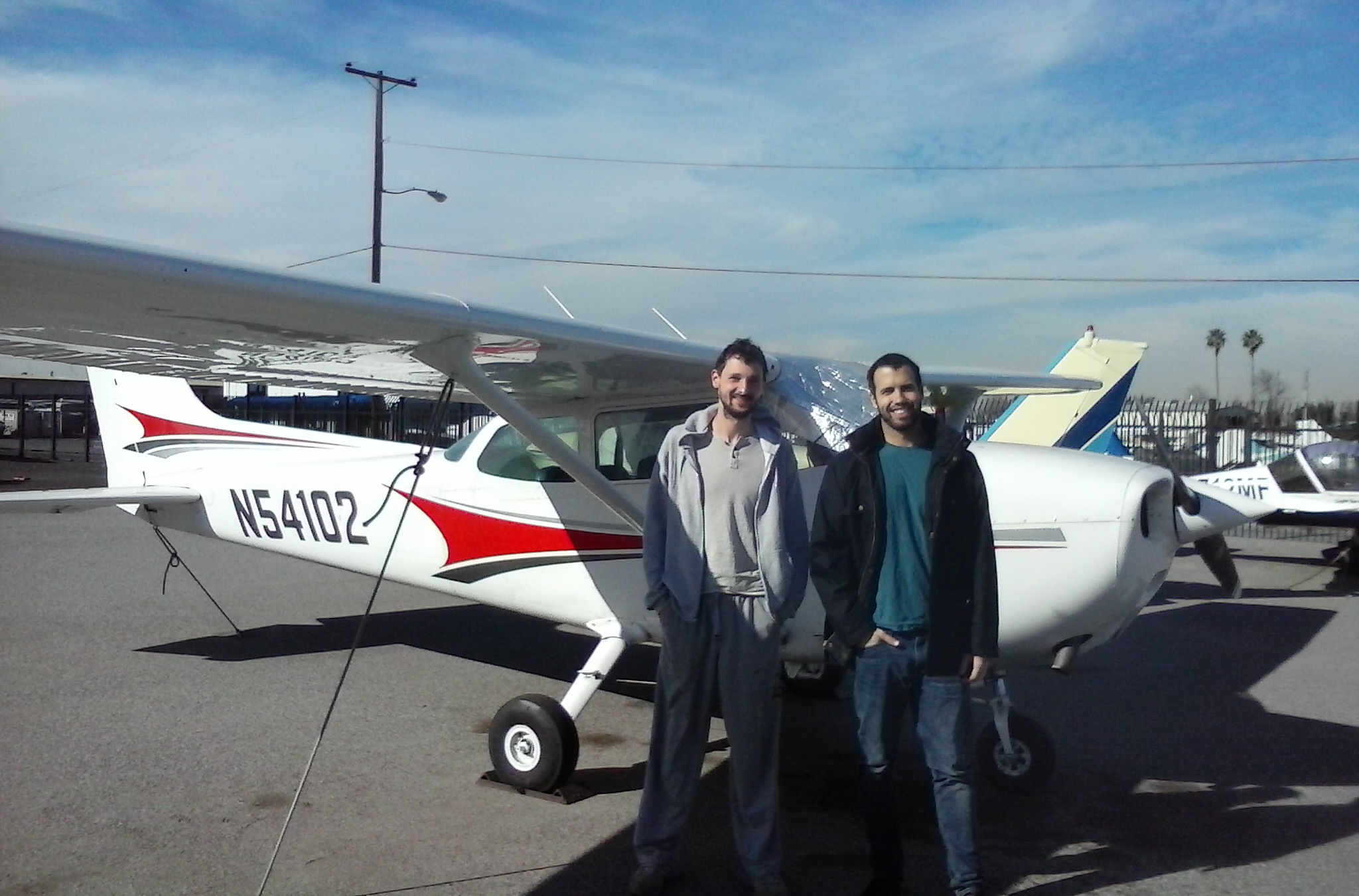 Dmitry Nikiforov and CFI Zach Sacchette after the well executed first solo!