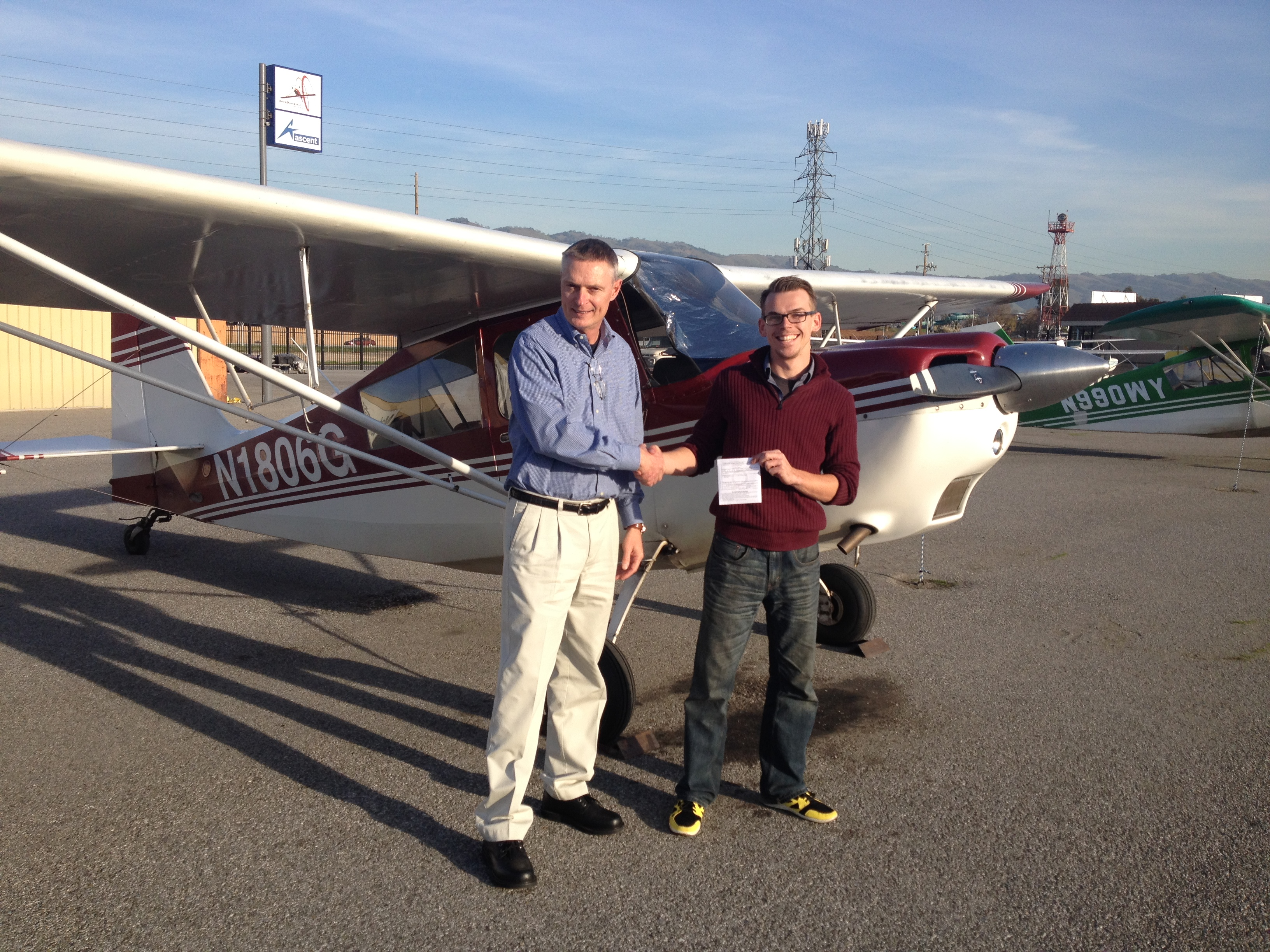 DPE Scott Rohlfing giving John Wilson the ticket to fly!