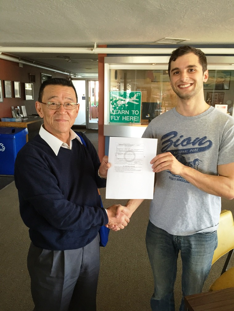 Ryan Marks receives his freshly printed pilot certificate at AeroDynamic Aviation Salinas